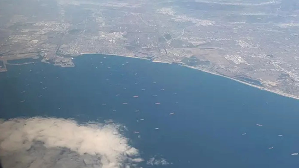 Take a Look at the Record-breaking Port Congestion From 10,000 Feet Above, As 70 Hulking Cargo Ships Park Off the LA Coast